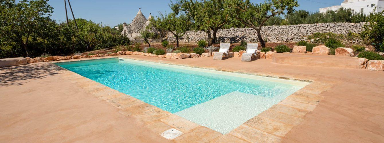 piscina skimmer telo sabbia e scala interna