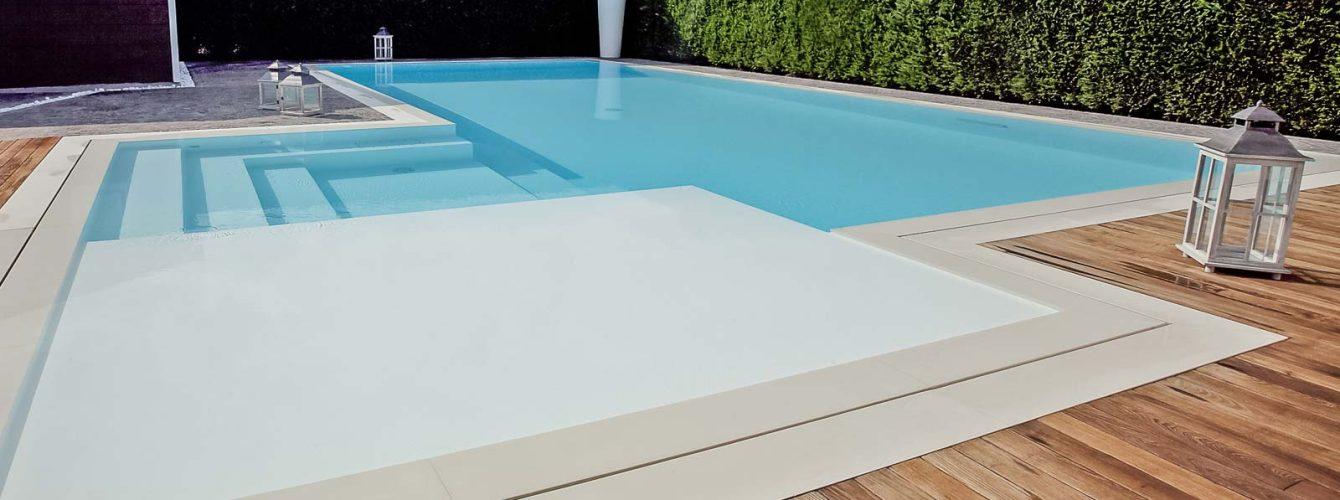 piscina color sabbia con sfioro trilogy e idromassaggio